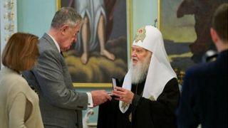 Филарет наградил экс-замдиректора ЦРУ орденом за поддержку Поместной Церкви