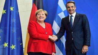 Мицотакис и Меркель обсудили миграционный кризис